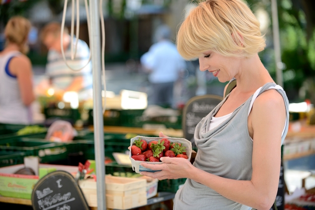 Woman buying strawberries at farmer's market
